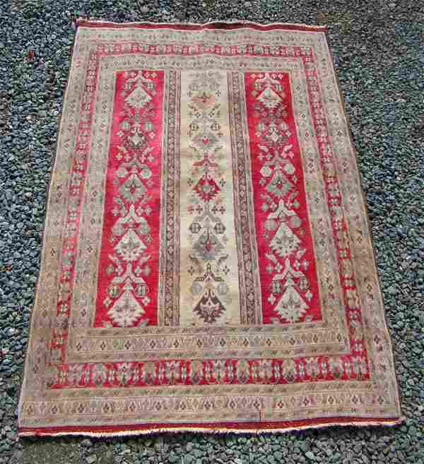 Persian Oriental scatter rug, 70 by 48 inches.