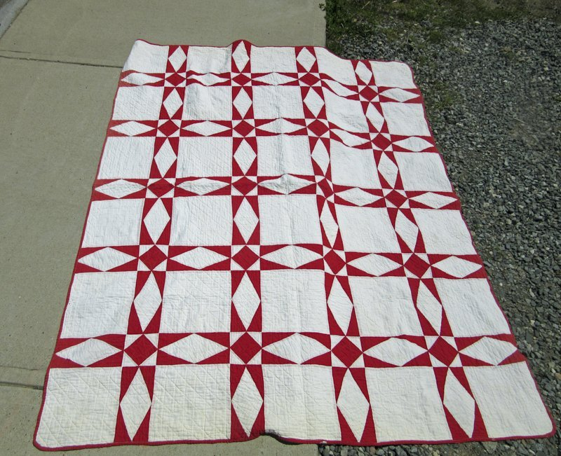 Red and white patchwork quilt, 80 by 63 inches.