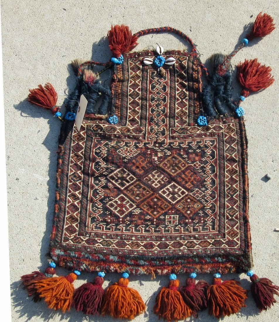 Old Soumak salt bag, 21 by 19 inches. Condition: good.