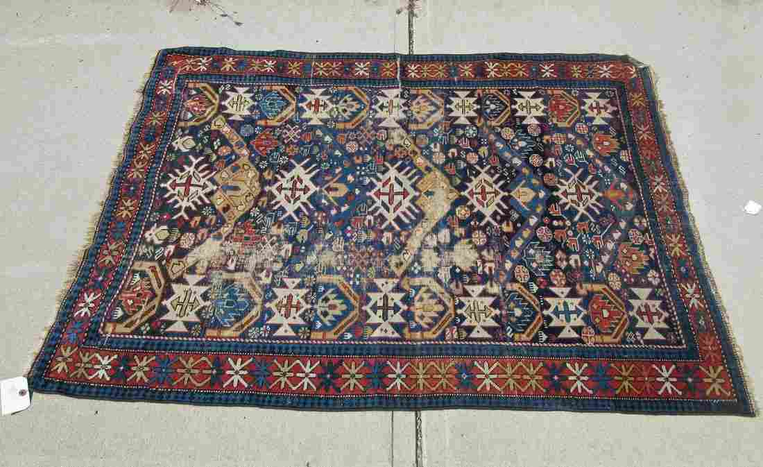 Old Kuba Oriental scatter rug, 61 by 45 inches.