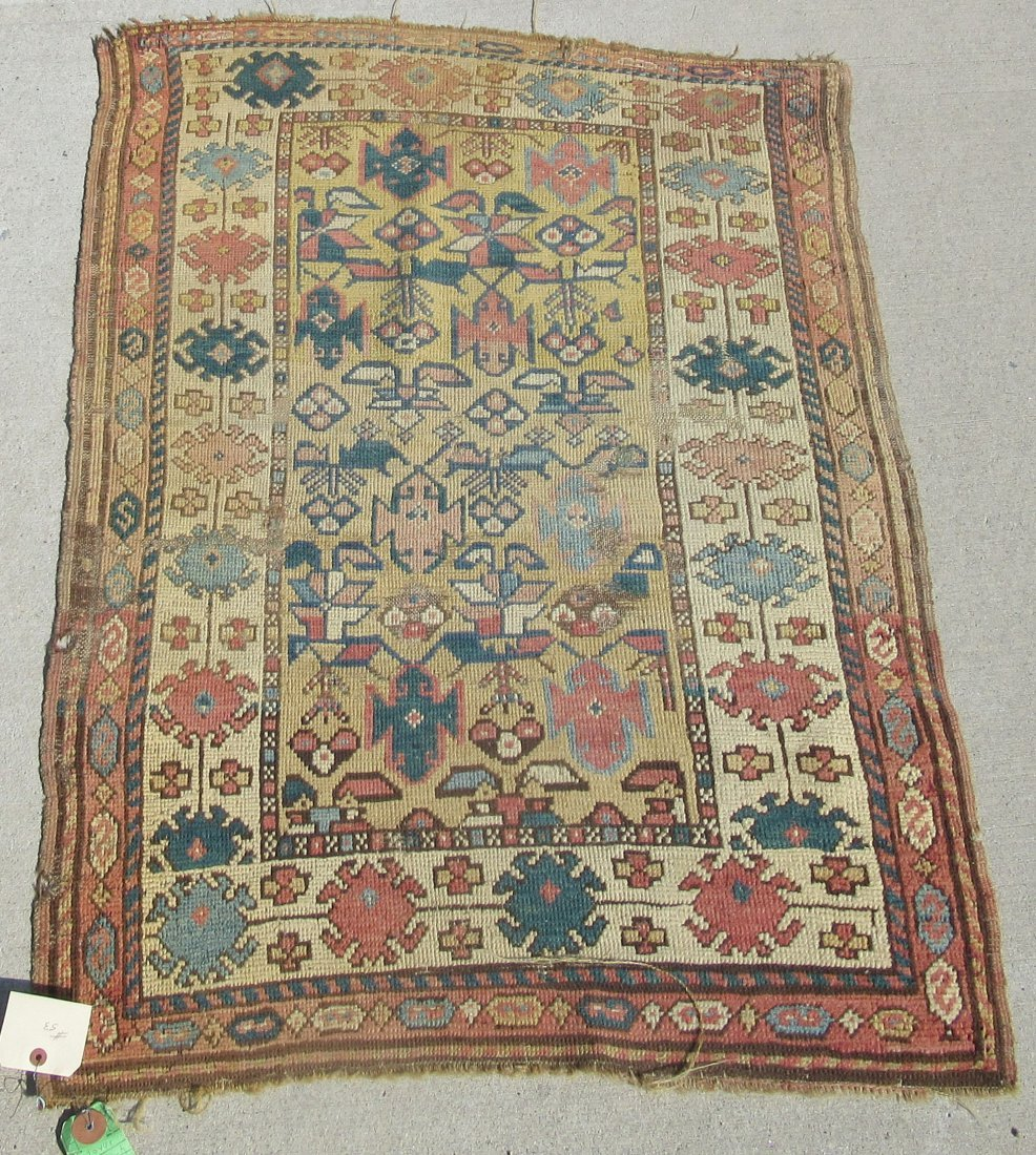 Old Caucasian Oriental scatter rug, 48 by 34 inches.