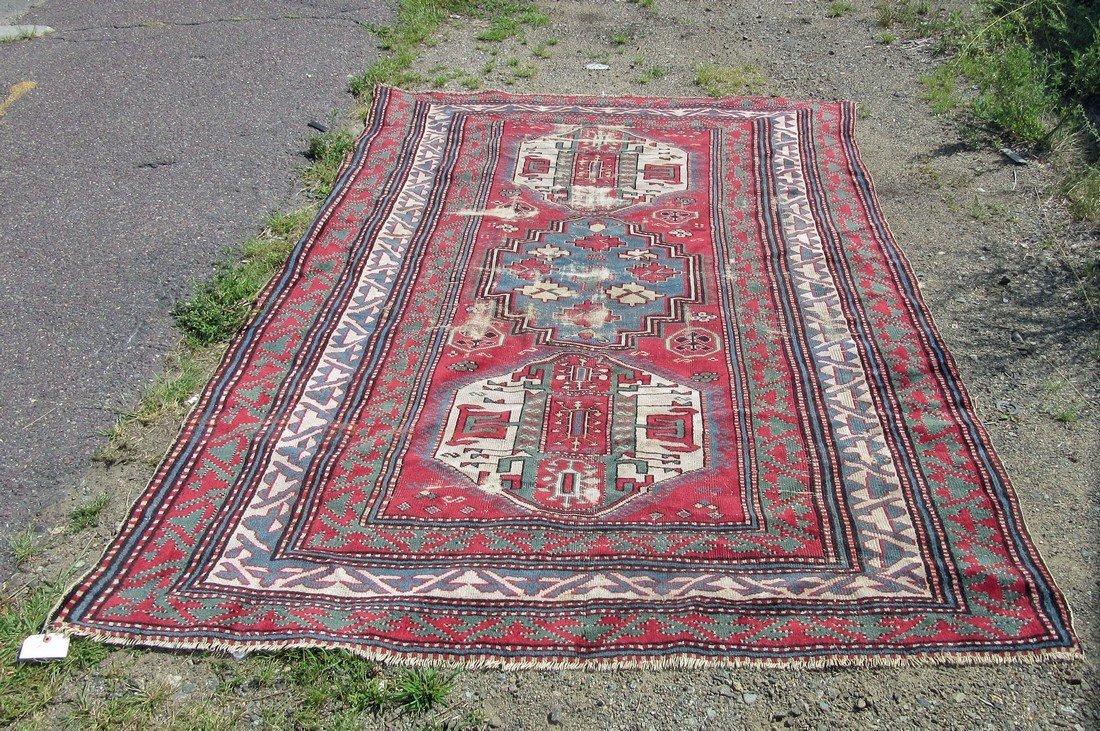 Antique Kazak Oriental rug, 72 by 104 inches.
