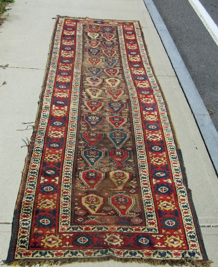 Old Caucasian Oriental long rug, 120 by 38 inches.