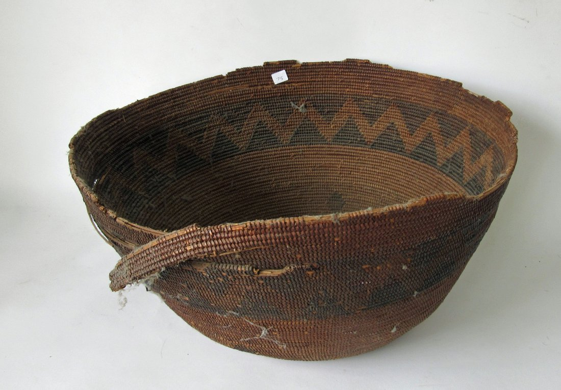 Antique decorated Indian basket, 19.5 diameter.