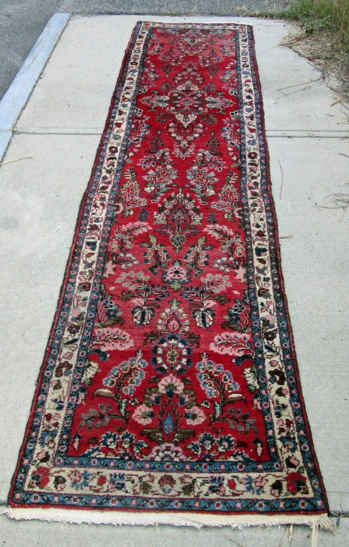 Persian Oriental runner, 132 by 29 inches. Condition: