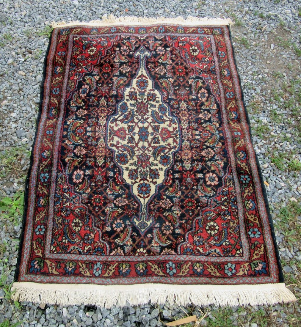 Old Blue Field Oriental carpet, 58 by 41 inches.