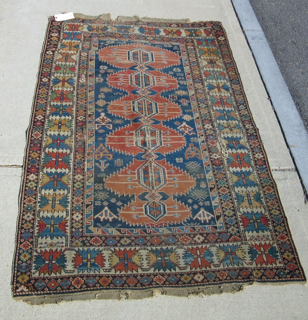 Old Caucasian Oriental rug, 70 by 46 inches. Condition: