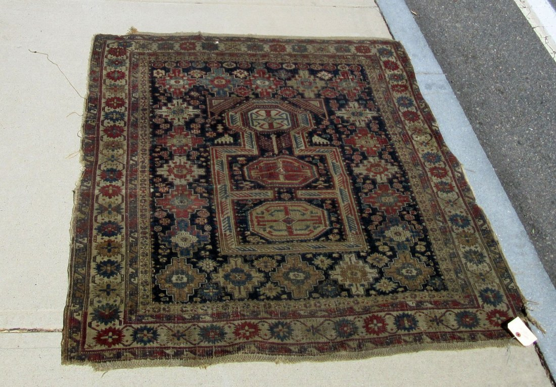 Old Kuba Oriental scatter rug, 58 by 45 inches.