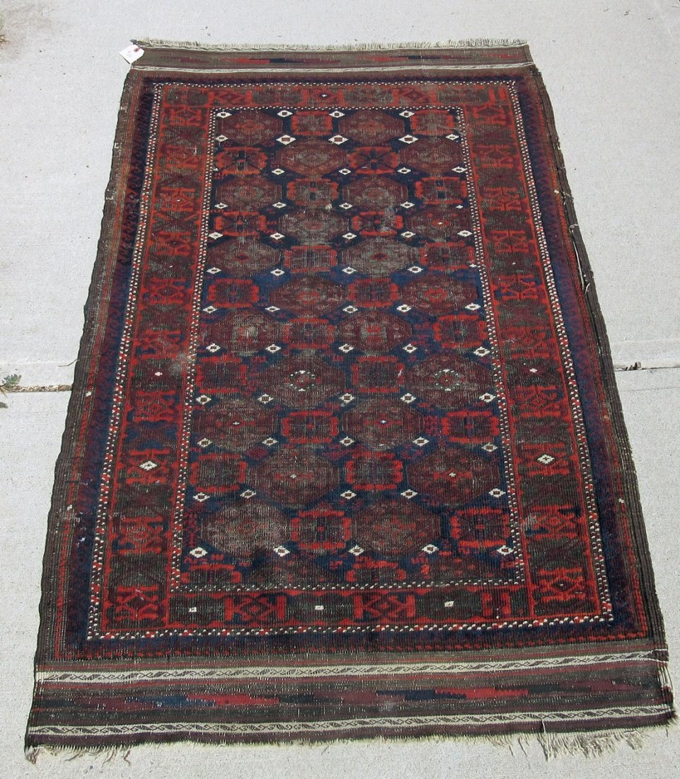 Old Baluch Oriental rug, 65 by 38 inches. Condition: