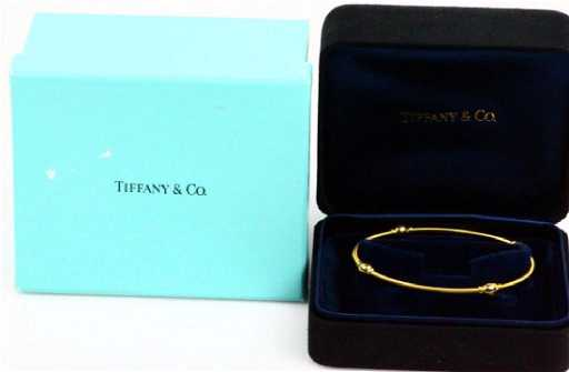 6689e554a Tiffany & Co 18K Coiled Cable Bangle Bracelet. placeholder