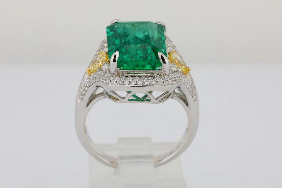 6.35ct Emerald, .8ctw Yellow/White Diamond 18K Ring - 9