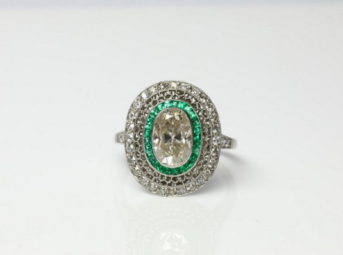 3.2ctw Diamond, 1ctw Emerald & Platinum Ring