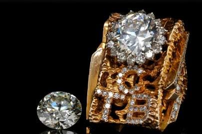 "Elvis Presley's 9.81ctw Diamond ""First"" TCB Ring"