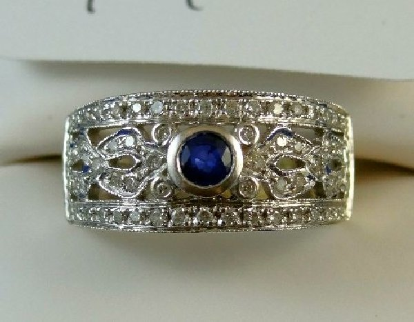 14D: 18K,1.25CTTW Diamond & .25CT Tanzanite Ring