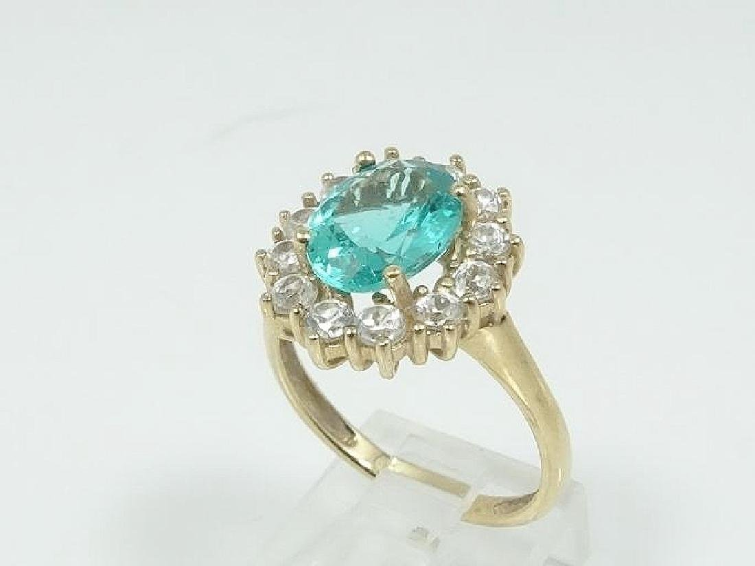 1.2ctw Diamond, 2.5ct Blue Topaz, & 10K Gold Ring