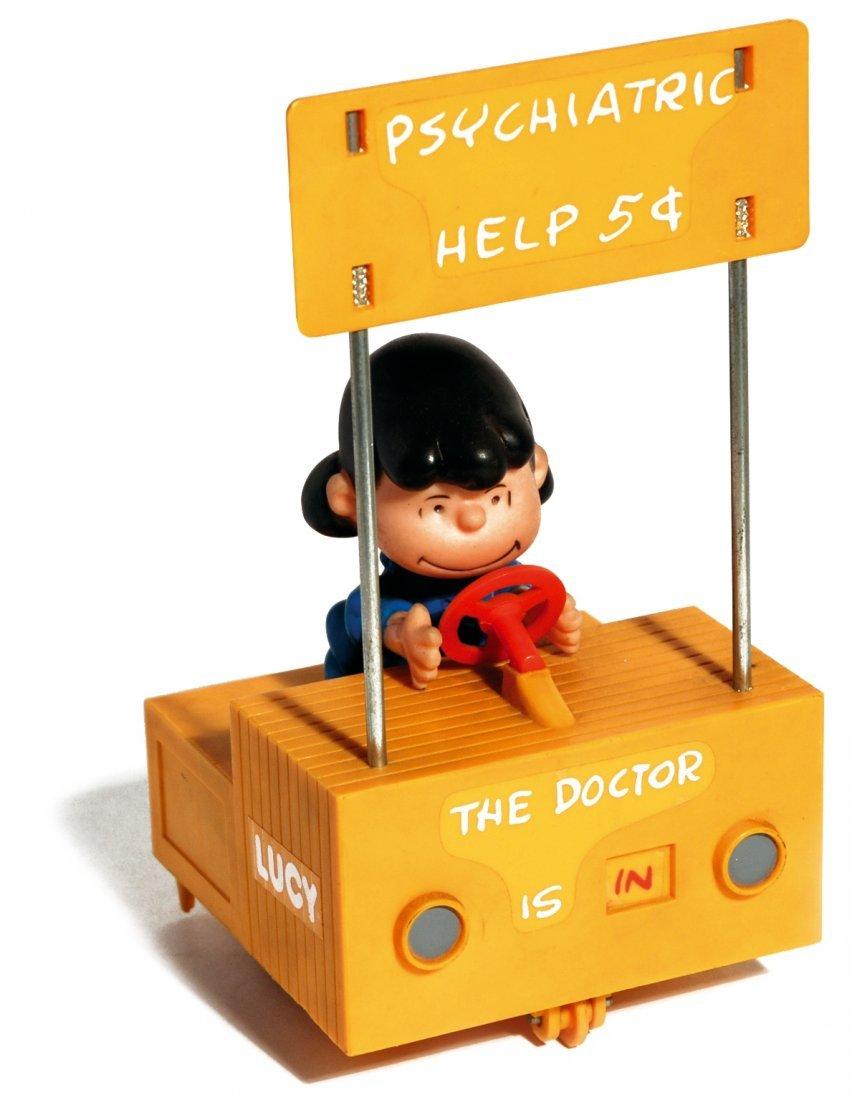 Snoopy motorized toy - Lucy psychiatric help