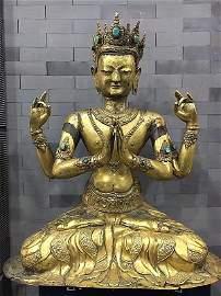 A Large Tibetan Antique Gilt Four-arm Guanyin Statu
