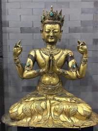 A Large Antique Gilt Four-arm Guanyin Statu