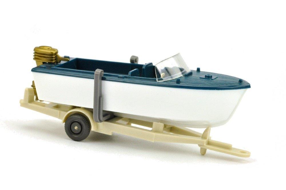 Motorboot auf Anhänger, ozeanblau