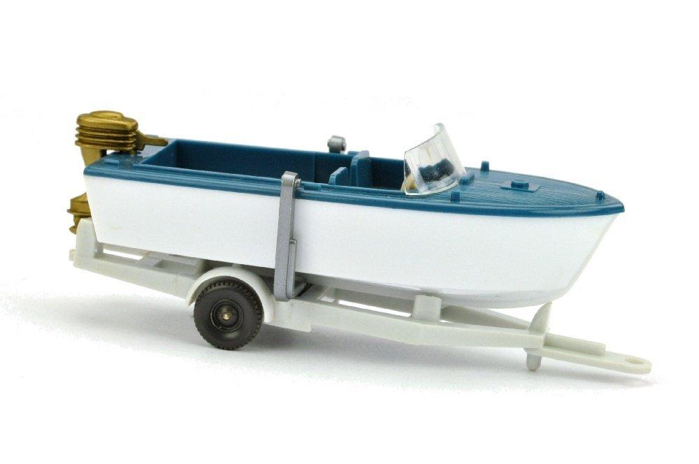 Motorboot auf Anhänger, azurblau