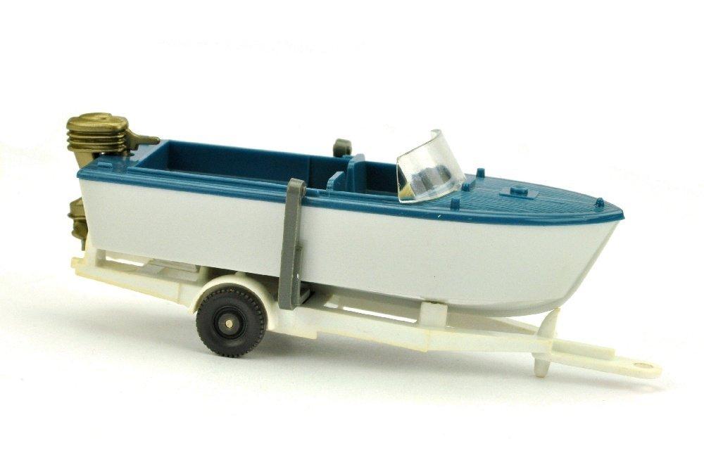 Motorboot auf Anhänger, azurblau/altweiß