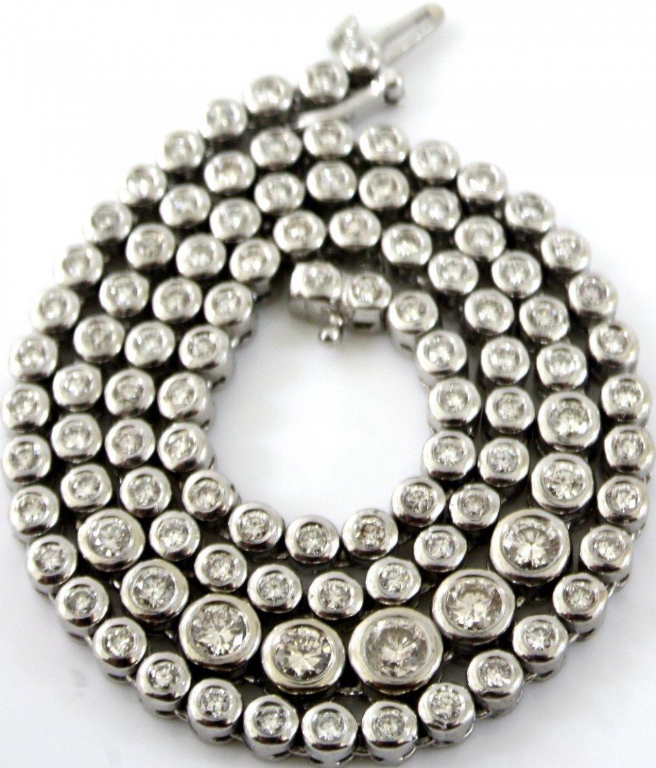 17: 14KT WHITE GOLD GRADUATED DIAMOND TENNIS NECKLACE