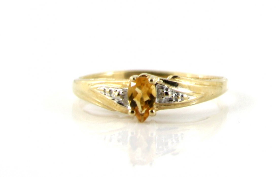 45: 10KT SOLID GOLD PEAR CUT CITRINE PROMISE RING