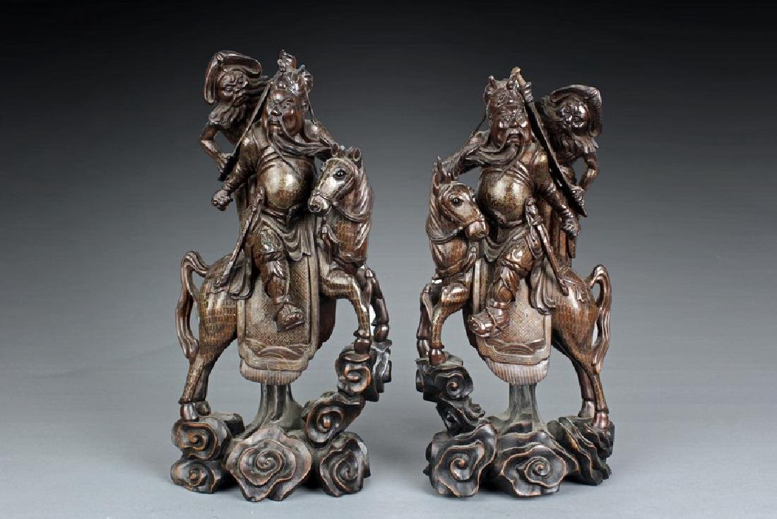 A PAIR OF WOODEN GUANYU ON HORSE CARVINGS INSET WITH SI