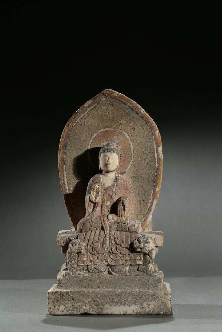 A STONE CARVED POLYCHROMED 'BUDDHIST' STELE