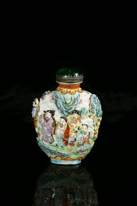 A FAMILLE ROSE MOULDED 'EIGHT IMMORTALS' SNUFF