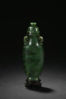 A SPINACH GREEN JADE CARVED HU-FORM VASE WITH COVER