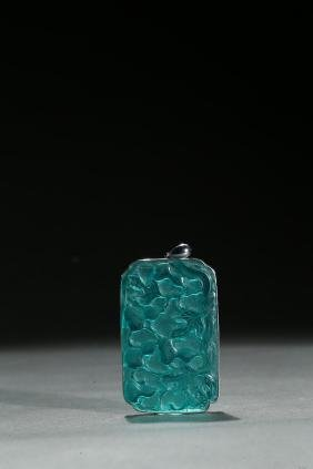 A TURQUOISE-GREEN GLASS 'GOURDS' PENDANT