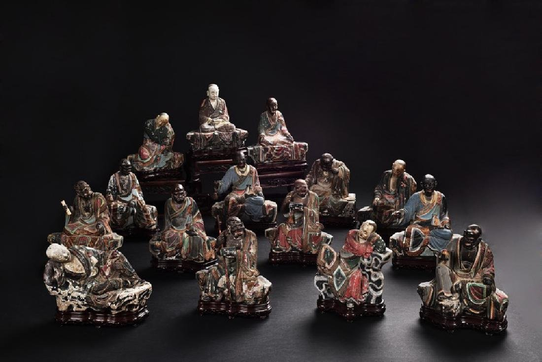 A GROUP OF POLYCHROME CLAY ARHAT FIGURES