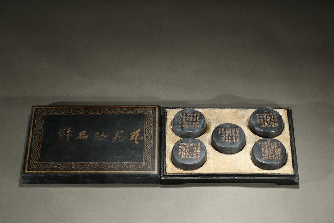 SET OF FIVE GILT INSCRIBED BARREL-FORM INKCAKES