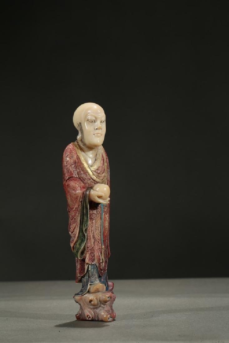 A SOAPSTONE CARVING OF STANDING LUOHAN - 4