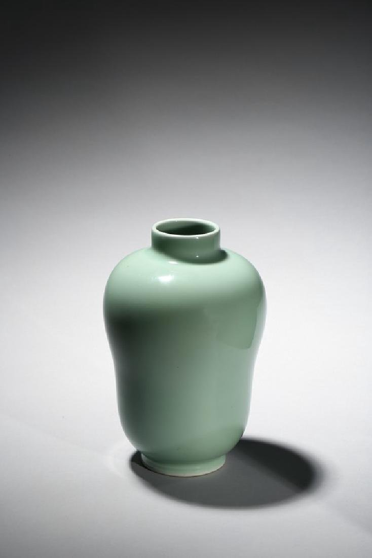 A CELADON GLAZED JAR