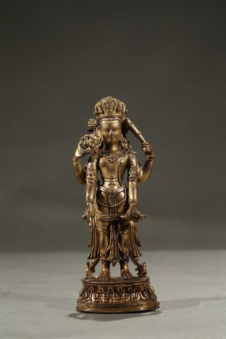 A GILT-BRONZE FIGURE OF STANDING DEITY