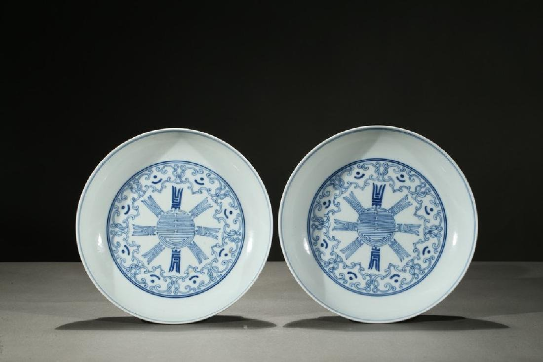 A PAIR OF BLUE AND WHITE SHOU DISHES
