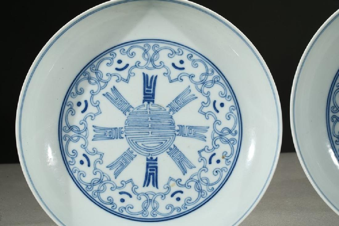 A PAIR OF BLUE AND WHITE SHOU DISHES - 2