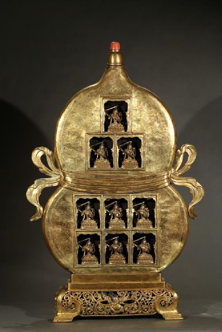 AN IMPERIAL GILT-BRONZE DOUBLE GOURD SHRINE