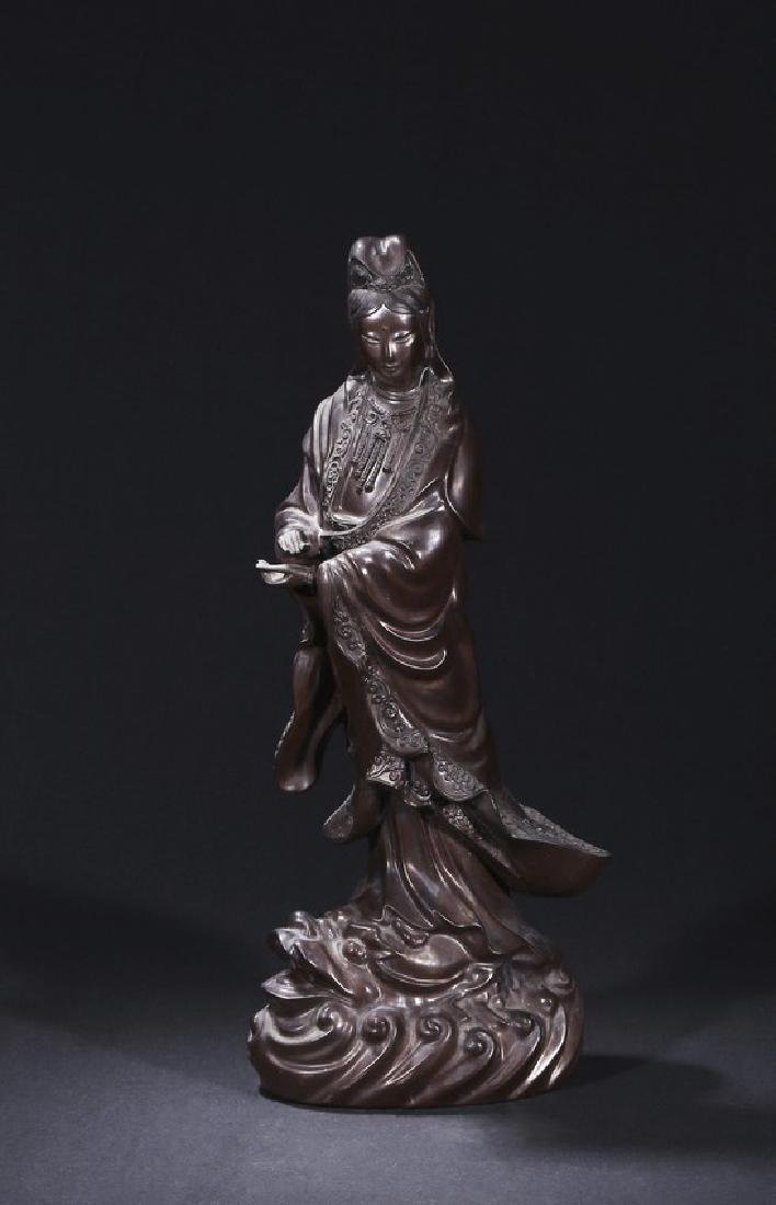 A BLACK DRY LACQUER FIGURE OF STANDING GUANYIN