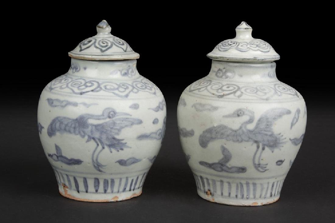 A PAIR OF BLUE AND WHITE 'CRANES' SMALL JARS WITH