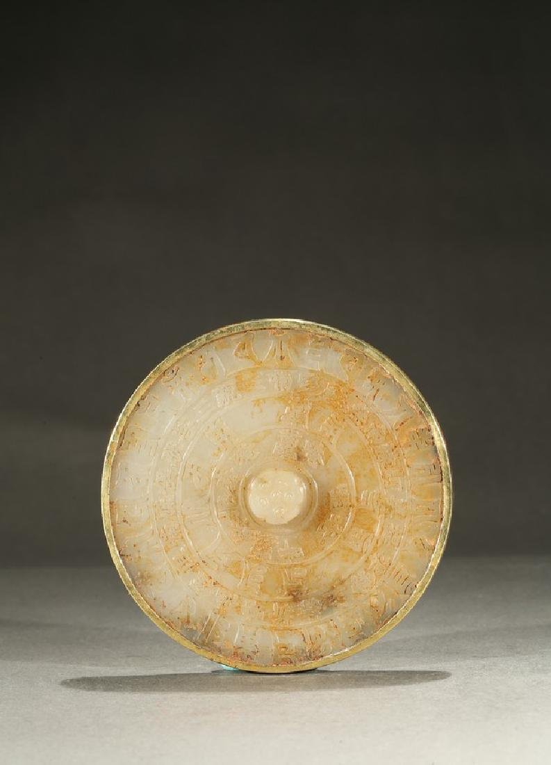 A GILT OR GOLD AND JADE 'BUDDHIST SCRIPT' PLATE