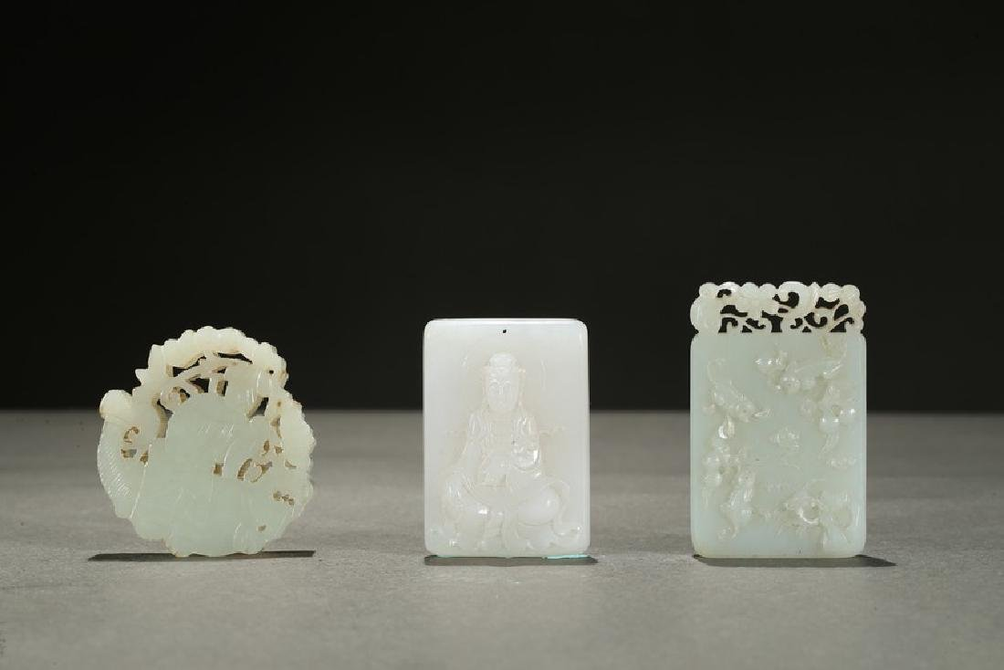 A GROUP OF THREE WHITE JADE ORNAMENTS