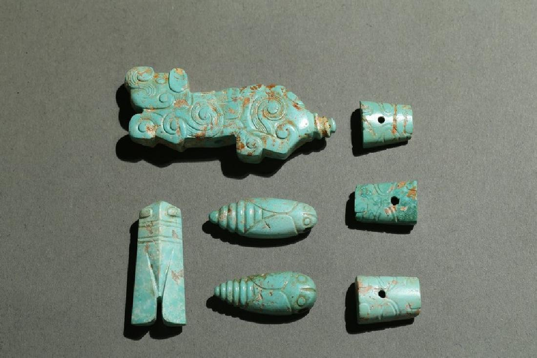 A GROUP OF ARCHAIC TURQUOISE CARVINGS