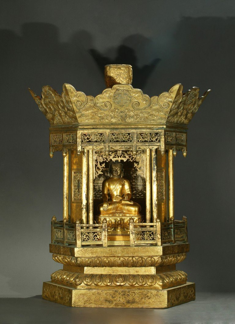 A LARGE AND RARE GILT-BRONZE BUDDHIST SHRINE AND BUDDHA