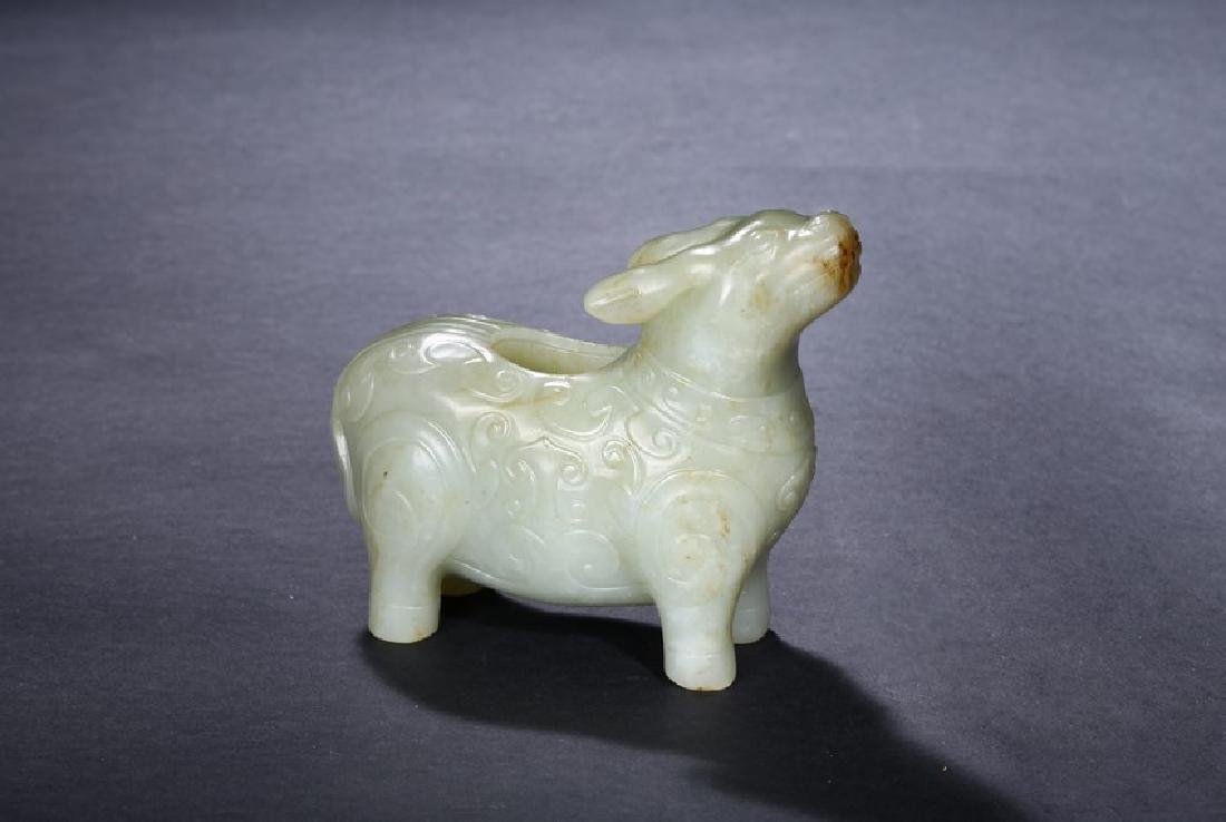A WHITE JADE ARCHAISTIC TAPIR-FORM VESSEL
