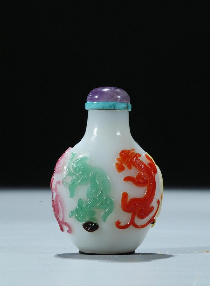 A FIVE-COLOR OVERLAY GLASS 'CHILONG' SNUFF BOTTLE