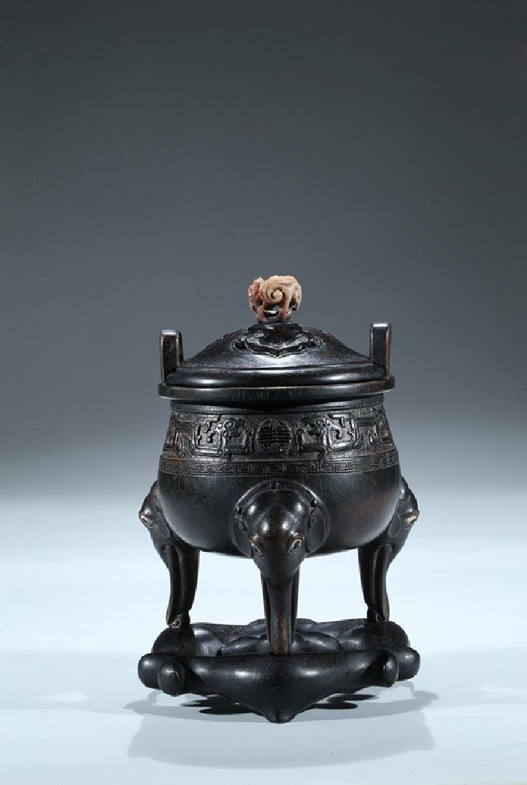 AN AGARWOOD CARVED TRIPOD CENSER WITH ZITAN STAND