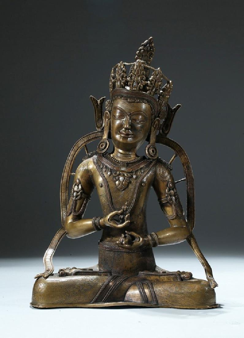 A COPPER AND SILVER INLAID COPPER ALLOY FIGURE OF